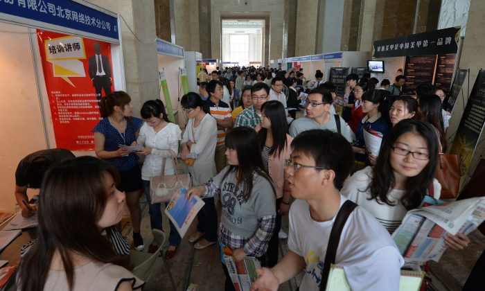 Chinese jobseekers attend a jobs fair in Beijing on May 18, 2013. Only 7.7 percent of over seven million graduates in China have signed contracts with companies during the first half of the year, a record low employment rate. (MARK RALSTON/AFP/Getty Images)