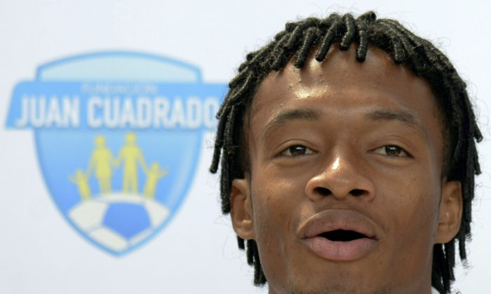 Colombia's Juan Cuadrado speaks during a press conference in Medellin, Antioquia department, Colombia on July 8, 201, two days after the World Cup squad arrived home Sunday after their historic run to the quarter-finals. (RAUL ARBOLEDA/AFP/Getty Images)