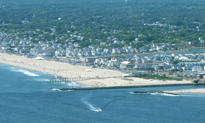 The Shark River Inlet in Belmar, N.J., July 11, 2014. Since the federal Environmental Protection Agency ended its flights along the coast this year, the New Jersey DEP is the only agency that does aerial pollution checks along the Jersey shore. (AP Photo/Wayne Parry)