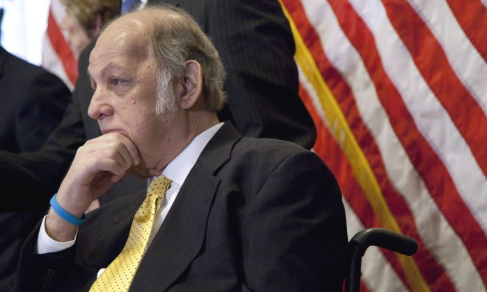 This March 30, 2011 photo shows former White House press secretary James Brady who was left paralyzed in the Reagan assassination attempt during a news conference on Capitol Hill in Washington marking the 30th anniversary of the shooting. A Brady family spokeswoman says Brady has died at 73. (AP Photo/Evan Vucci)