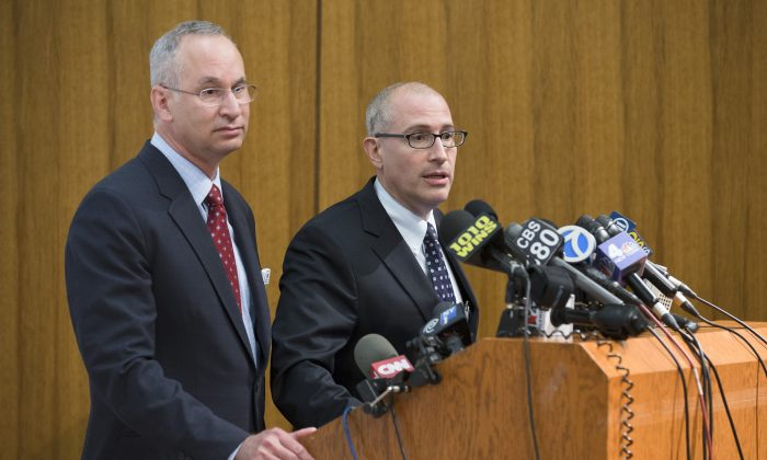Jeremy Boal, Chief Medical Officer for the Mount Sinai Health System (C), speaks during a news conference alongside David Reich, President of Mount Sinai Hospital (L), at Mount Sinai Medical Center, where a male patient with a high fever and gastrointestinal symptoms is undergoing testing in New York City for the Ebola virus, following a recent trip to West Africa, Aug. 4. (AP Photo/John Minchillo)