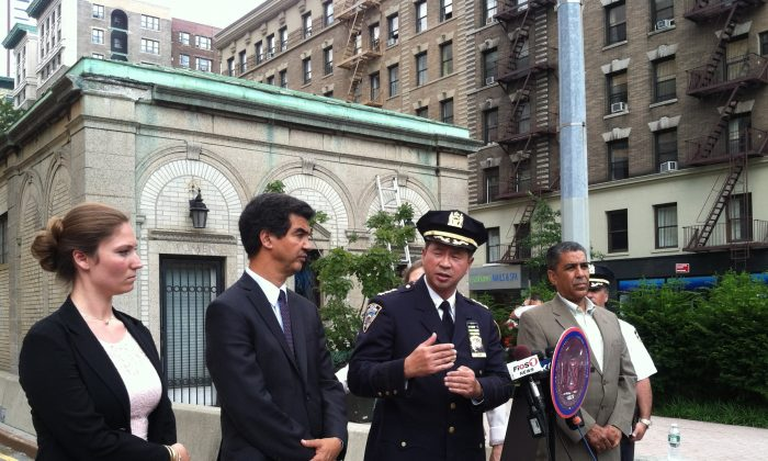 NYPD transportation chief Thomas Chan (C) at a press conference on the Upper West Side, Manhattan, N.Y., on Aug. 4, 2014. A new reduced 25 mph speed limit is in effect along Broadway from 59th St. to 220th St. (Annie Wu/Epoch Times)