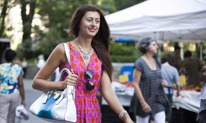 Janna Melonkvist walks with a Michael Kors handbag in Union Square, Manhattan, on Aug. 4, 2014. Melonkvist said that she likes Michael Kors because it is good quality at a good price. (Samira Bouaou/Epoch Times)