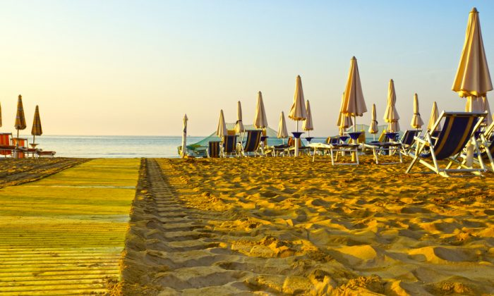 umbrellas on the beaches of Italy in the morning hour. (*Shutterstock)