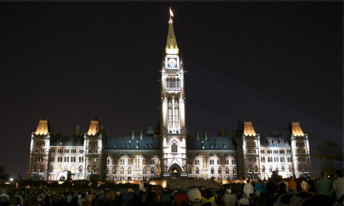 The Centre Block of Canada's Parliament buildings lights up with scenes from Canada's history in the free sound and light show, Mosaika. (Matthew Little/Epoch Times)