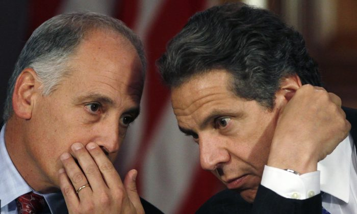 Larry Schwartz (L) secretary to the governor, talks to New York Gov. Andrew Cuomo during a cabinet meeting at the Capitol in Albany, N.Y., on Wednesday, May 9, 2012. (Mike Groll/Associated Press)