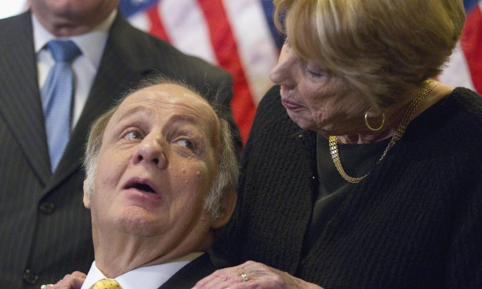 Former White House press secretary James Brady (L), and his wife Sarah Brady, on Capitol Hill in Washington, March 30, 2011. (Evan Vucci/AP)