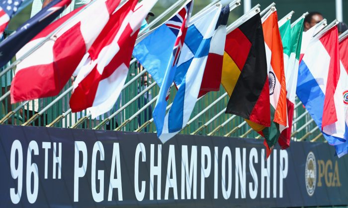 Flags fly above a PGA Championship sign during a practice round prior to the start of the 96th PGA Championship at Valhalla Golf Club on August 4, 2014 in Louisville, Kentucky. (Warren Little/Getty Images)