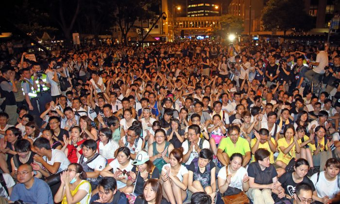 Peaceful overnight sit-in protest following July 1, 2014 march held by Hong Kong Federation of Students, aiming for civil disobedience, launching the first wave of non-violent civil struggle. (Epoch Times)