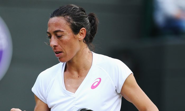 Francesca Schiavone of Italy in action during her Ladies' Singles first round match against Ana Ivanovic of Serbia on day two of the Wimbledon Lawn Tennis Championships at the All England Lawn Tennis and Croquet Club at Wimbledon on June 24, 2014 in London, England. (Jan Kruger/Getty Images)