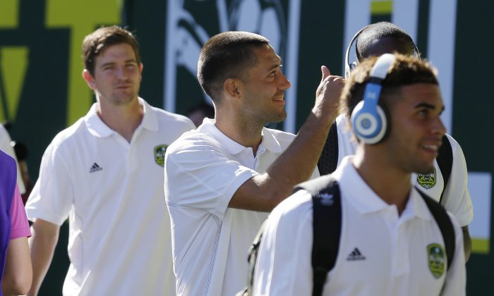 MLS All-Stars. including Seattle Sounders midfielder Clint Dempsey, center, arrive for the MLS All-Star soccer match against Bayern Munich, Wednesday, Aug. 6, 2014, in Portland, Ore. (AP Photo/Ted S. Warren)