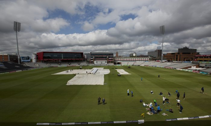 India players gather for a nets session at Old Trafford cricket ground before the fourth test match of their five match series against England in Manchester, England, Wednesday, Aug. 6, 2014. (AP Photo/Jon Super)