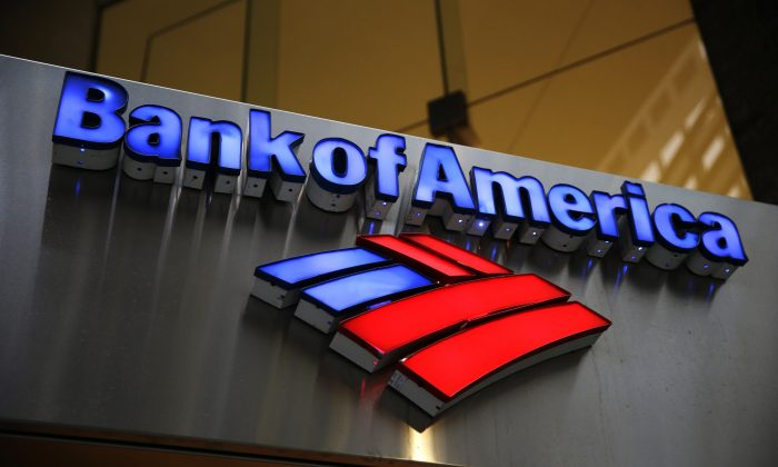 In this Jan. 14, 2014, photo, a Bank of America sign is photographed in Philadelphia. Bank of America reported its 2015 earnings today. (AP Photo/Matt Rourke)