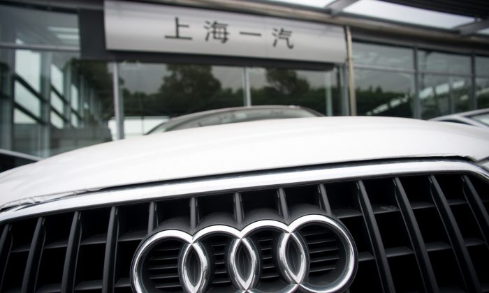An Audi is pictured in front of a car dealer in Shanghai on Aug. 6, 2014. German luxury car maker Audi and Chrysler of the United States have committed 'monopoly behaviour' in China and will be punished soon, the country's regulator said. (JOHANNES EISELE/AFP/Getty Images)