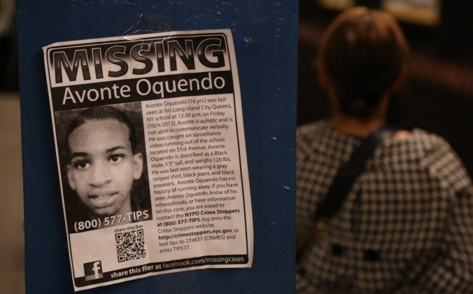A poster of Avonte Oquendo, an autistic New York City teen found dead more than three months after he vanished from his school, posted at a subway stop, in Brooklyn, N.Y., on Oct. 16, 2013. (Christian Watjen/Epoch Times)