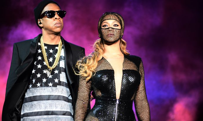 Beyonce and JAY Z perform during the Beyonce and Jay Z - On the Run tour at AT&T Park on Tuesday, Aug. 5, 2014, in San Francisco. (Mason Poole/Invision for Parkwood Entertainment/AP Images)