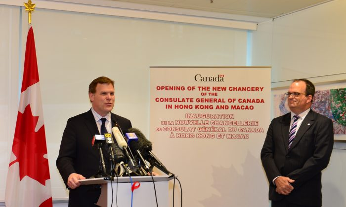 Canadian Foreign Minister, the Hon. John Baird addressing media and guests at the opening of the new Canadian Consular Office at 5/F, Tower 3, Exchange Square, Hong Kong on Wednesday Aug 6 together with J. Ian Burchett, the Canadian Consul General of Hong Kong and Macau. (Bill Cox/Epoch Times)