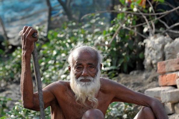 An elderly Bangladeshi man looks on at a village near the Sunderbans in Khulna, some 350 kms southwest of Dhaka, on March 31, 2009. The Sundarbans, which means 'beautiful jungle' in Bengali, is the world's largest mangrove forest covering an area over 10,000 square kilometres. (Munir Uz Zaman/AFP/Getty Images)