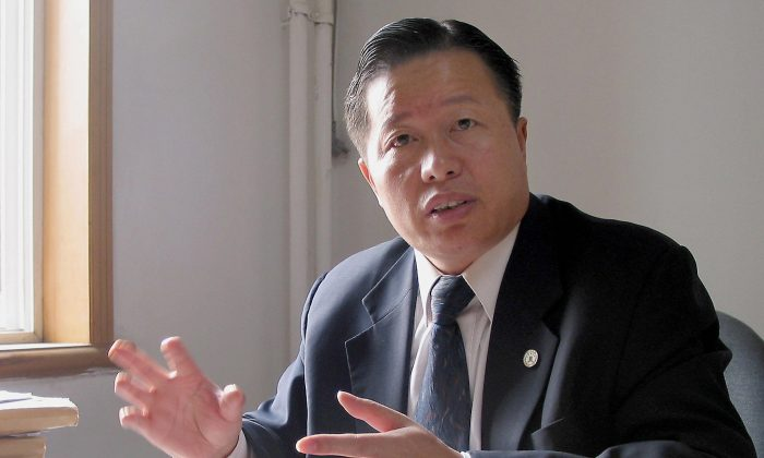 Gao Zhisheng gives an interview at his office in Beijing, 02 November 2005. The prominent Chinese human-rights lawyer has been released from prison after five and a half years. (Verna Yu/AFP/Getty Images)