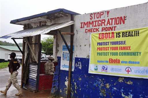 Soldiers clamped down on people trying to travel to Liberia's capital this Thursday from rural areas, hard-hit by the Ebola virus, hours after the president declared a national state of emergency. (AP Photo/Abbas Dulleh)
