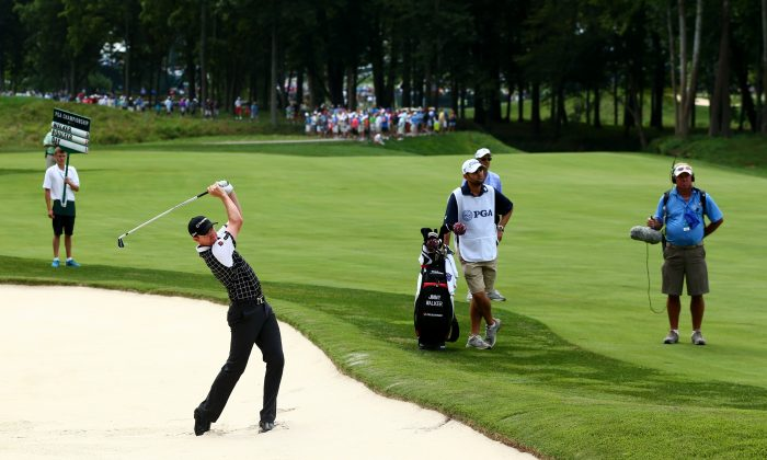 Jimmy Walker hits an approach shot from a bunker on the second hole during the first round of the 96th PGA Championship at Valhalla Golf Club. (Jeff Gross/Getty Images)