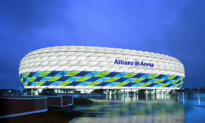 In this handout image from the Allianz Group, the Allianz Arena is illuminated with white, green and blue lights ahead of the UEFA Champions League Final between FC Bayern Munich and Chelsea. The final takes place at the Allianz Arena on May 19, 2012. (Photo by Allianz Group via Getty Images)