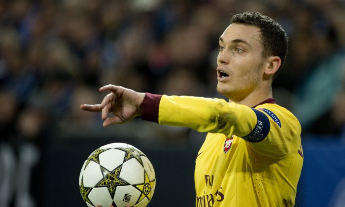 Arsenal's Belgian defender and captain Thomas Vermaelen prepares for a throw during the UEFA Champions league group B football match between Schalke 04 and Arsenal in Gelsenkirchen on November 6, 2012. The match ended in a 2-2 draw. (ODD ANDERSEN/AFP/Getty Images)