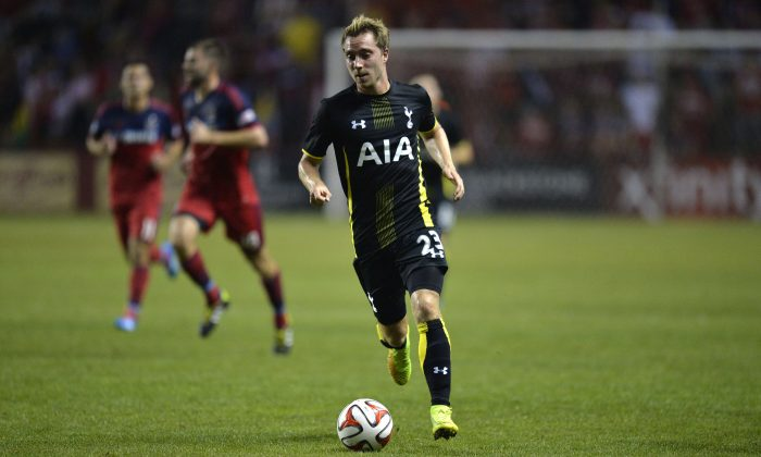 Christian Eriksen #23 of Tottenham Hotspur moves the ball up the field during the second half against the Chicago Fire at Toyota Park on July 26, 2014 in Bridgeview, Illinois. Tottenham Hotspur defeated the Fire 2-0. (Photo by Brian Kersey/Getty Images)