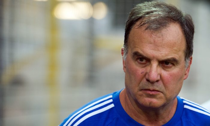 Marseille's Argentinian head coach Marcelo Bielsa attends the friendly football match Olympique de Marseille vs Chievo Verona on August 2, 2014 in Le Pontet, southern France. (BERTRAND LANGLOIS/AFP/Getty Images)