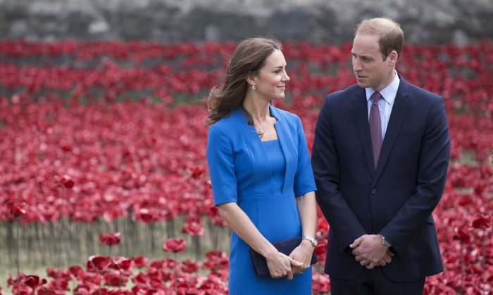 Catherine, Duchess of Cambridge and Prince William, Duke of Cambridge walk through an installation entitled 'Blood Swept Lands and Seas of Red' by artist Paul Cummins, made up of 888,246 ceramic poppies in the moat of the Tower of London, to commemorate the First World War on August 5, 2014 in London, England. (Oli Scarff/Getty Images)