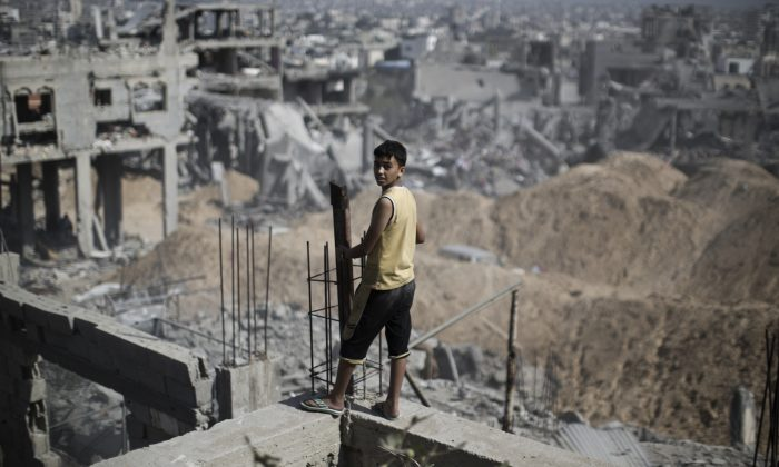 A Palestinian youth looks out at the destruction in part of Gaza City's al-Tufah neighborhood. David Harris of the American Jewish Committee names and praises the countries he says understand the moral issues in the recent Gaza conflict. (MAHMUD HAMS/AFP/Getty Images)