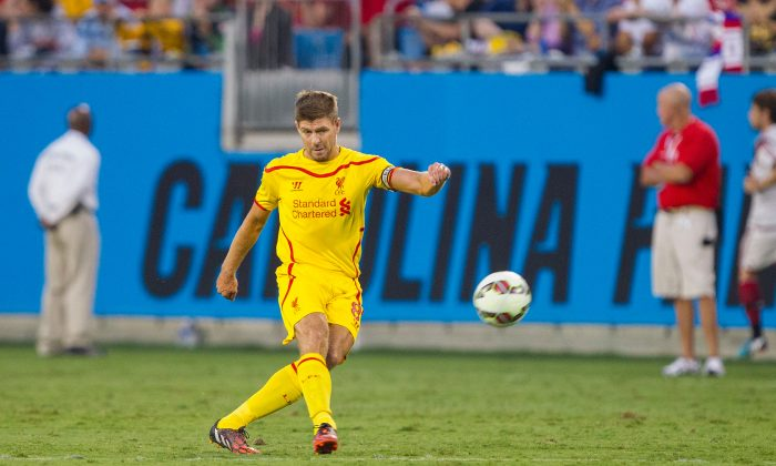 Steven Gerrard #8 of Liverpool passes the ball against A.C. Milan in the Guinness International Champions Cup at Bank of America Stadium on August 2, 2014 in Charlotte, North Carolina. Liverpool defeated A.C. Milan 2-0. (Photo by Brian A. Westerholt/Getty Images)