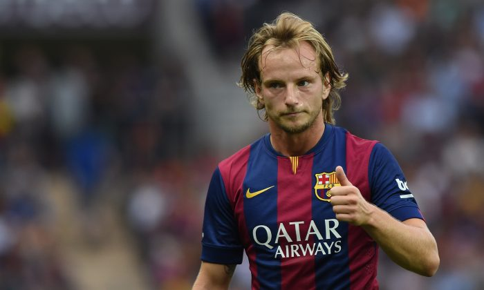 Ivan Rakitic of FC Barcelona gestures during the pre-season friendly match between FC Barcelona and SSC Napoli on August 6, 2014 in Geneva, Switzerland. (Photo by Valerio Pennicino/Getty Images)