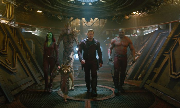 """L to R: Gamora (Zoe Saldana), Rocket (Voiced by Bradley Cooper), Groot (Voiced by Vin Diesel), Star-Lord/Peter Quill (Chris Pratt) and Drax (Dave Bautista) in a screen still from this summer's blockbuster """"Guardians of the Galaxy."""" (Film Frame/Marvel)"""