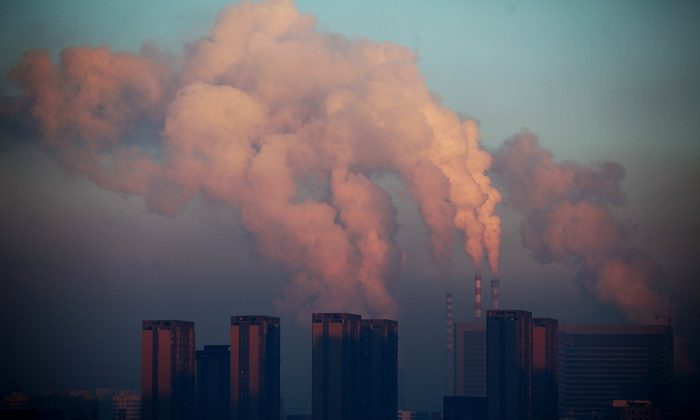 A thermal power plant discharging heavy smog into the air in Changchun, northeast China's Jilin Province, in January 2013. (STR/AFP/Getty Images)