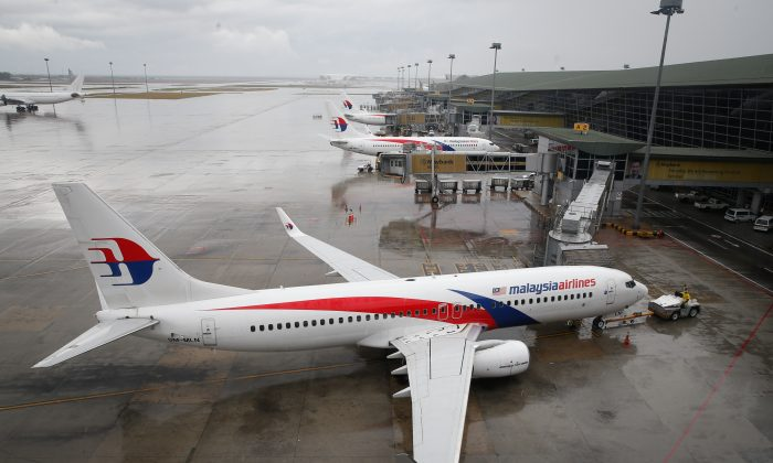 A Malaysia Airlines Boeing 737-800 plane sits on tarmac at Kuala Lumpur International Airport in Sepang, Malaysia, Friday, Aug. 8, 2014. (AP Photo/Vincent Thian)