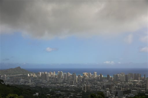 Clouds hang over Honolulu, seen from the top of Tanalus Drive on Thursday, Aug. 7, 2014. (AP Photo/Marco Garcia)