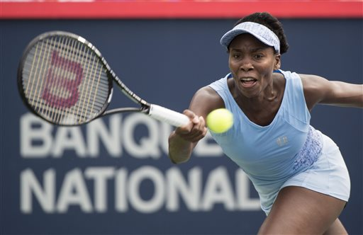 Venus Williams returns to Carla Suarez Navarro from Spain at the Rogers Cup tennis tournament, Friday, Aug. 8, 2014 in Montreal. (AP Photo/The Canadian Press, Paul Chiasson)