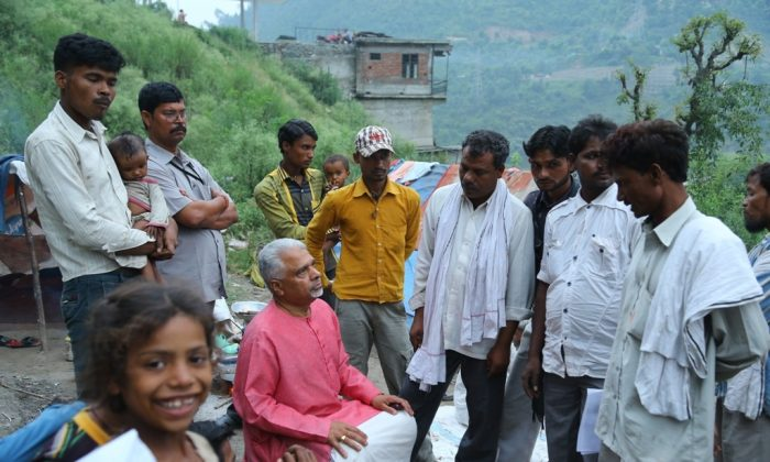 Lawyer, Activist Sarachandra Bose and a group of volunteers interact with villagers in central India while on travel around the country on 26 July 2014. Bose travelling around the country for 55-days campaigning against caste. (Special arrangement)