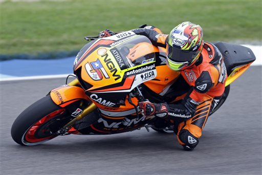 Colin Edwards rides during the first practice for the Indianapolis Moto GP motorcycle race at the Indianapolis Motor Speedway in Indianapolis, Friday, Aug. 8, 2014. In a young man's sport, Colin Edwards seems like a dinosaur. The 40-year-old American has been chasing the elusive world title for more than a decade. (AP Photo/Michael Conroy)