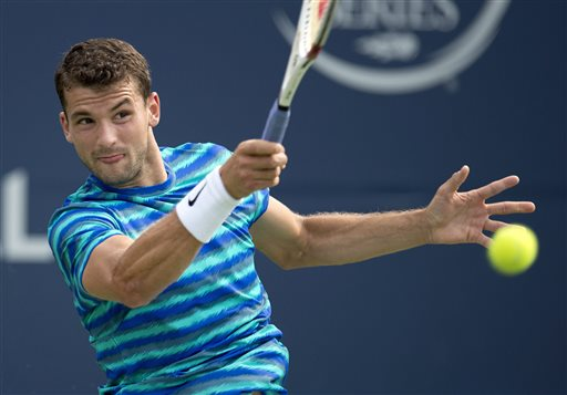 Grigor Dimitrov of Bulgaria hits a forehand to Kevin Anderson of South Africa at the Rogers Cup tennis tournament, Friday, Aug. 8, 2014 in Toronto. (AP Photo/The Canadian Press, Frank Gunn)