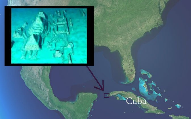 Map of North America seen from space with Cuba indicated. (Shutterstock*) The arrow is pointing to the west coast of Cuba, where underwater stone structures were discovered in 2001 by Pauline Zalitzki and Paul Weinzweig. (Screenshot/The Cosmos News/Youtube)