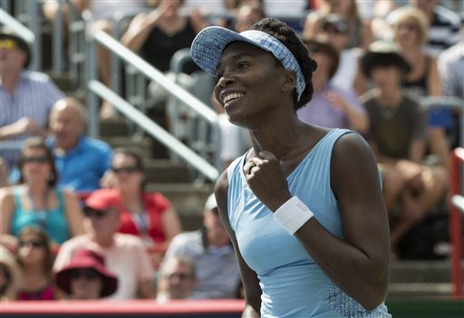 Venus Williams of the United States celebrates after beating her sister Serena 6-7, 6-2, 6-3 during semifinal play at the Rogers Cup tennis tournament Saturday, Aug. 9, 2014 in Montreal. (AP Photo/The Canadian Press, Paul Chiasson)