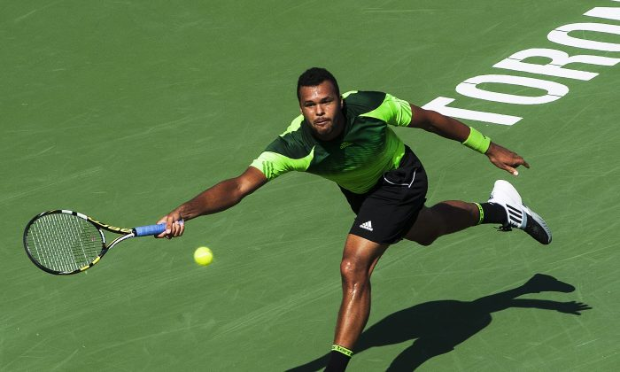 Jo-Wilfried Tsonga of France returns the ball against Roger Federer of Switzerland during the Rogers Cup Men's tennis tournament final in Toronto on August 10, 2014. (The Canadian Press/Aaron Vincent Elkaim)