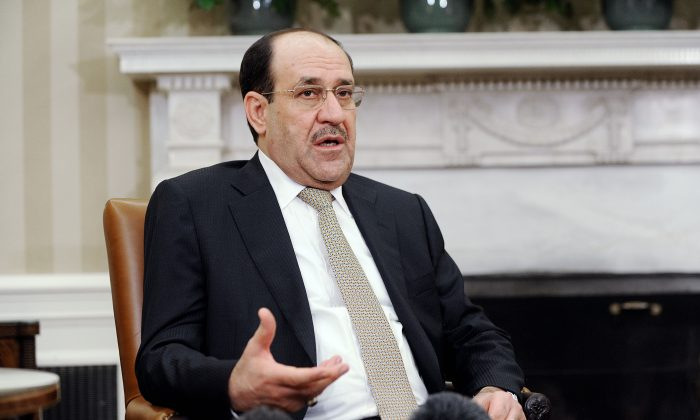 Iraqi Prime Minister Nouri Al-Maliki speaks during a meeting with U.S. President Barack Obama in the Oval Office at the White House November 1, 2013 in Washington, DC. Maliki is at the center of a political crisis in Iraq and rumors of a coup in Baghdad aimed at keeping him in power. (Olivier Douliery-Pool/Getty Images)