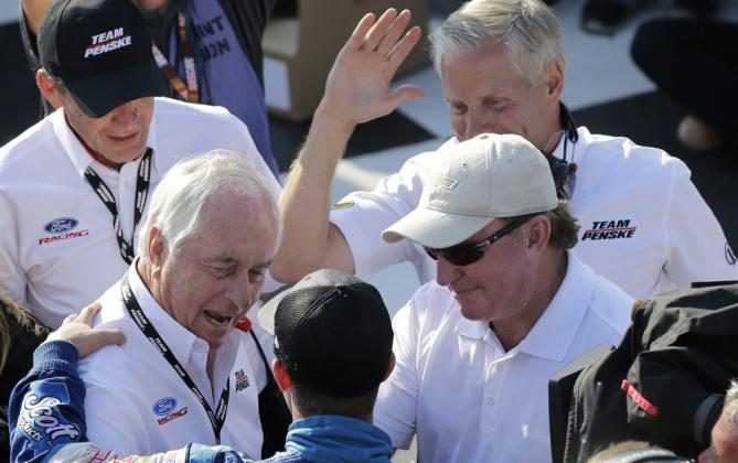 AJ Allmendinger is congratulated by team owners Roger Penske and Richard Childress.