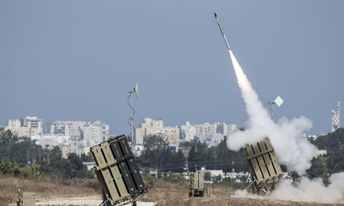 The Iron Dome air-defense system fires to intercept a rocket over the city of Ashdod, Israel, on July 8, 2014. (Ilia Yefimovich/Getty Images)