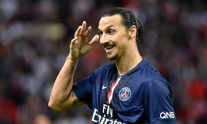 Paris Saint-Germain's Swedish forward Zlatan Ibrahimovic gestures during a French L1 football match between Reims and Paris Saint-Germain (PSG), on August 8, 2014 at the Auguste Delaune Stadium in Reims. (PHILIPPE HUGUEN/AFP/Getty Images)