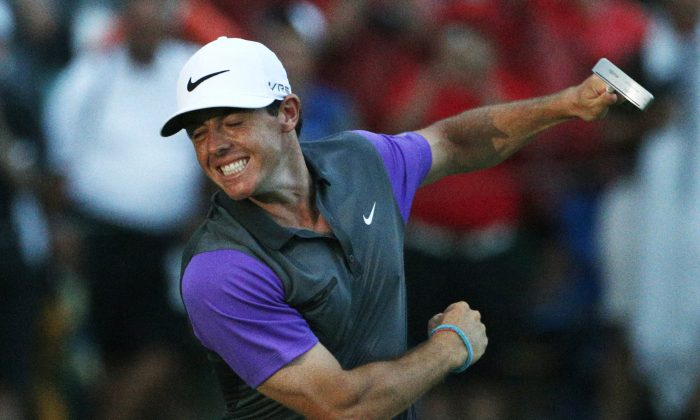 Rory McIlroy, of Northern Ireland, celebrates after winning the PGA Championship golf tournament at Valhalla Golf Club on Sunday, Aug. 10, 2014, in Louisville, Ky. (AP Photo/Mike Groll)