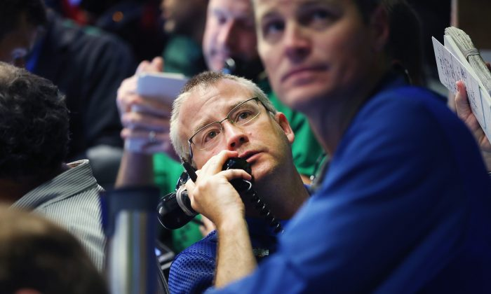 A trader takes an order in the options pit at the Chicago Board Options Exchange (CBOE) on July 30. (Scott Olson/Getty Images)